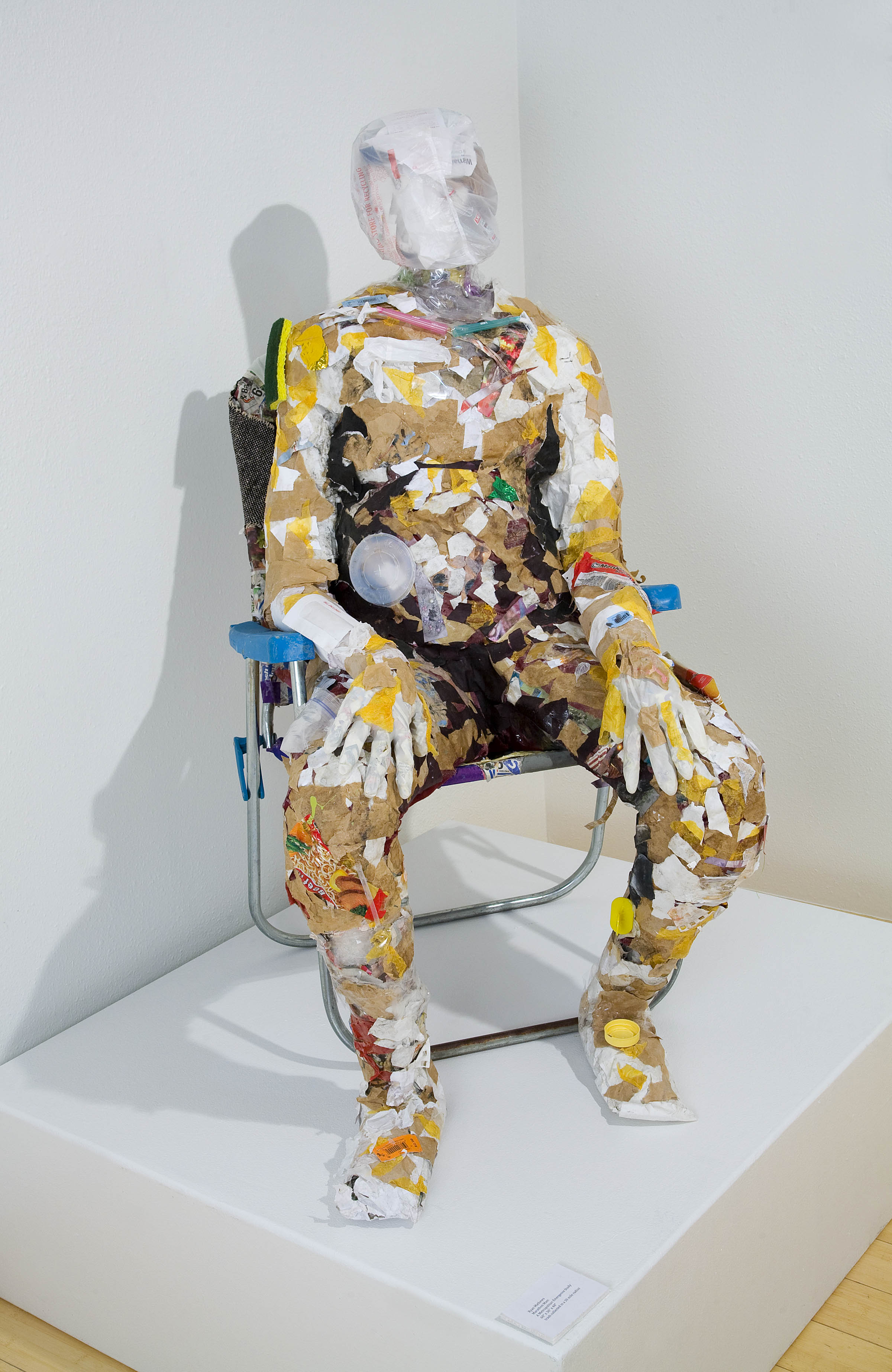Paper Humanoid in lawn chair sculpture