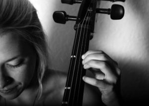 Close up photo of a woman playing cello